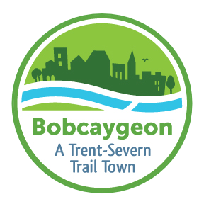 """Logo with town silhouette against flowing water that reads """"Bobcaygeon: A Trent-Severn Trail Town"""""""