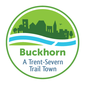"Logo with town silhouette against flowing water that reads ""Buckhorn: A Trent-Severn Trail Town"""