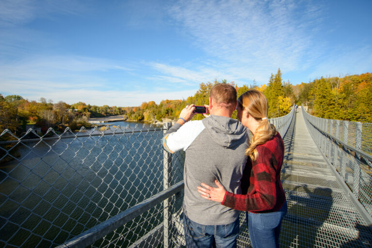 A man and a woman look out over the Ranney Gorge Suspension bridge
