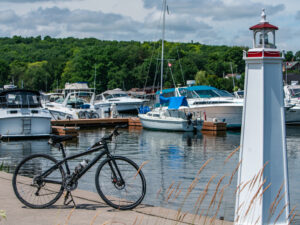A bike stands beside a miniature lighthouse at the Hastings Marina