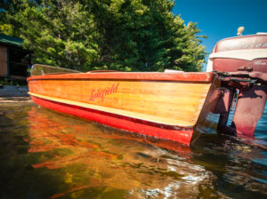 A wooden boat with Lakefield painted on the side