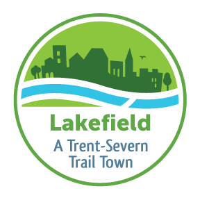 "Logo with town silhouette against flowing water that reads ""Lakefield: A Trent-Severn Trail Town"""
