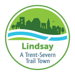"""Logo with town silhouette against flowing water that reads """"Lindsay: A Trent-Severn Trail Town"""""""