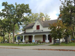 Exterior of Maryboro Lodge, Fenelon Falls, a cream-coloured historical building with a long porch
