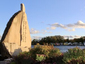 """Rock monument with """"Fenelon Falls"""" written on it in vertical lettering, photographed around sunset with soft light hitting it"""